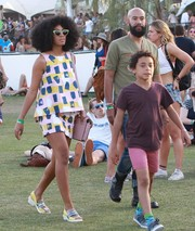 Solange Knowles continued the yellow-blue motif with a pair of flat PVC sandals.