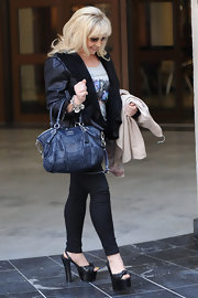 Charlene Tilton was seen walking with a pair of platform slingbacks at the ITV studios.