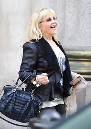 Charlene Tilton was spotted leaving the ITV Studios wearing a hip leather jacket with a suede collar.