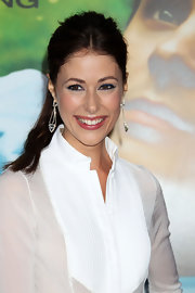Amanda Crew showed off her long dangling earrings while hitting the premiere of 'Charlie St. Cloud'.