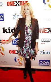 Charlize loves her blazers! The blond bombshell wore her favorite style with a floral dress and opaque tights.