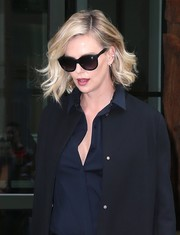 Charlize Theron stepped out in New York City looking stylish in her Paul Smith cateye sunnies.