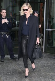 Charlize Theron looked perfectly put together in L'Agence leather pants teamed with a navy button-down.