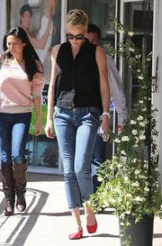 Charlize Theron stepped out looking ready for the sun in this sleeveless black button down.