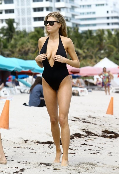 Charlotte McKinney flaunted her figure in a plunging halter one-piece by Solid & Striped.
