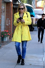 Chelsea Handler brightened up the pavement with her lemon-yellow trenchcoat while strolling in Beverly Hills.