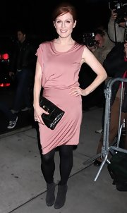 Julianne kept warm in her cocktail dress with black tights and suede ankle boots.