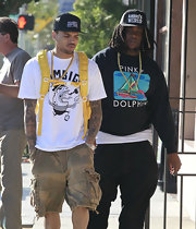 Chris Brown kept his bling sparse with a single strand ld chain necklace.