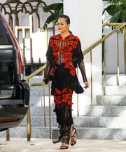 Chrissy Teigen couldn't be missed in this ornately embroidered and fringed lace gown by Raisa & Vanessa while out in Miami.