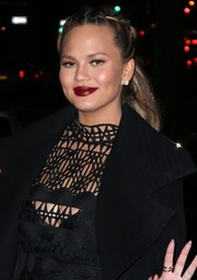 Chrissy Teigen looked cute with her partially braided ponytail while enjoying a date night.