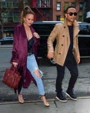 Chrissy Teigen's purple satin duster and low-cut black top were a very sexy pairing!