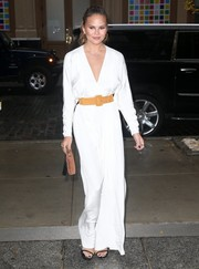 Chrissy Teigen stepped out in New York City looking sharp in a white V-neck jumpsuit.