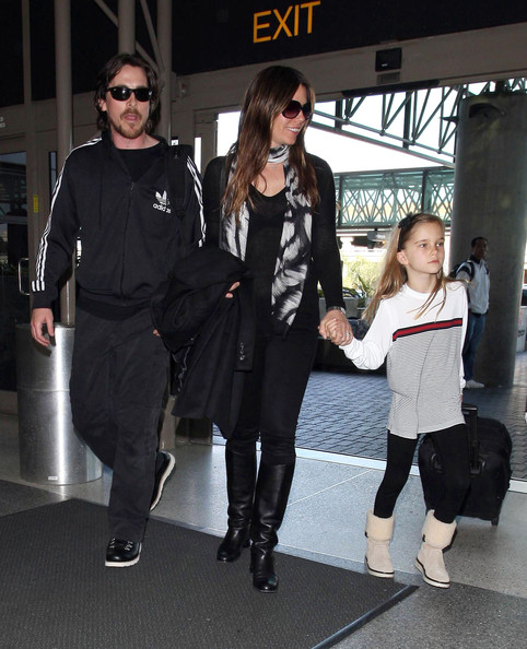 Sibi Blazic cut the monotony of her all-black travel ensemble with a patterned scarf.