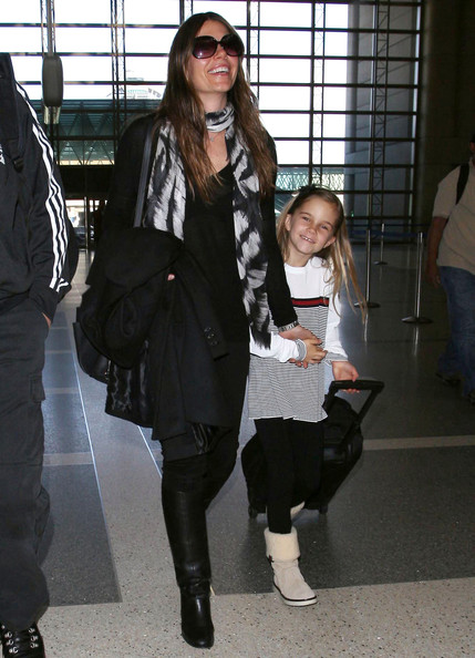 Sibi Blazic was spotted at LAX looking edgy in knee-high boots and a dark outfit.