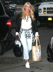 Christie Brinkley had her hands full with a summery straw tote along with a black leather bag.