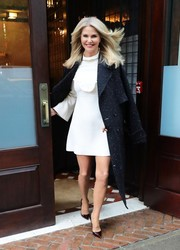 Christie Brinkley completed her ensemble with a pair of burgundy pumps by Christian Louboutin.