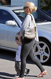 Christina paired her grey leggings with a chain embellished shoulder bag.