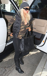 Christina Aguilera rocked an edgier look in black leather boots.