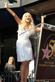 Christina wore a gathered little white dress to receive her Hollywood Star.