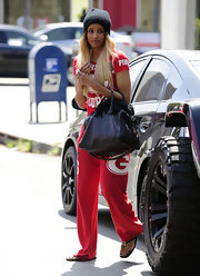 Ciara showed her love of football with a pair of red sporty sweatpants.