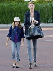 Kaya Gerber looked just as chic as mom in a navy swing jacket.