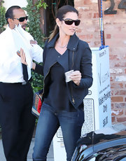 Cindy Crawford maintained her sleek street style in a black leather jacket and silky tank.