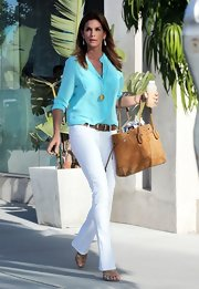 Cindy Crawford was totally summertime appropriate in this aqua blue button down and white jeans.