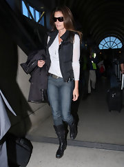 Cindy Crawford was a sight to behold at the airport in fitted indigo jeans and buckled boots.