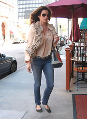 Cindy kept her look casual in suede flats.