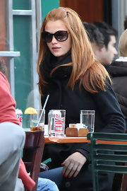 Cintia Dicker was spotted out for lunch with her locks tied half-up.