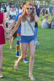 Emma Roberts teamed her top with a pair of Levi's cutoffs.