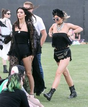 Kylie Jenner attended Coachella wearing a slinky black lace-trimmed tube top and matching shorts by Milk the Goat.