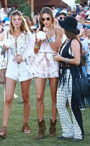 Alessandra Ambrosio stepped out for Coachella looking breezy and sexy in a white ále by Alessandra camisole.