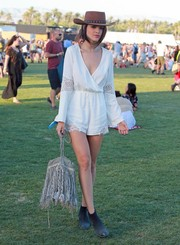Eiza Gonzalez accessorized with a gray suede shoulder bag featuring a Coachella staple: fringe.