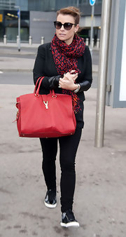 Coleen Rooney complemented her leopard print scarf with a bright red leather tote.