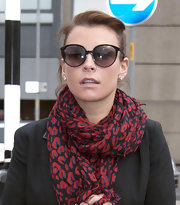 Coleen Rooney upped the glamor of her travel attire with a pair of large cateye shades.