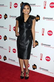 Jeannie Mai contrasted her edgy dress with a pair of vintage-y strappy black platform pumps.
