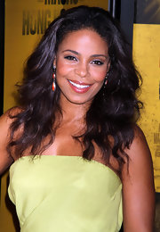 Sanaa Lathan paired her sweet yellow dress with bright coral earrings.