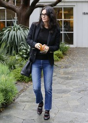 Courteney Cox completed her outfit with a pair of black suede and leather loafers.