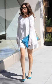 Crystal Reed matched her shoes with a blue Miu Miu matelasse clutch.
