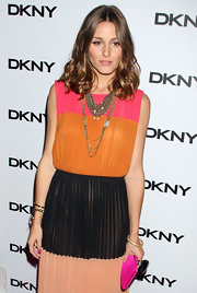 Olivia Palermo indulged in summer's hottest trend—colorblocking—for a DKNY event in New York. She finished off the look with layered necklaces and a curly 'do.