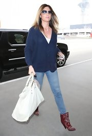 Daisy Fuentes chose a casual, baggy cardigan for her travel look while heading out of LA.