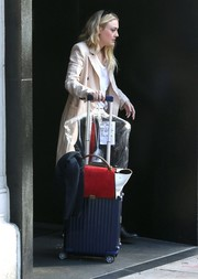Dakota Fanning headed out in New York City lugging along a blue Rimowa suitcase.