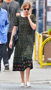 Dakota Johnson stepped out in New York City wearing a sweet floral frock.