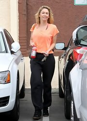Kym Johnson chose a peach tee for her relaxed rehearsal look.
