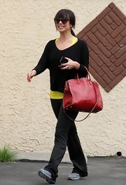 Cheryl Burke traded in her glittery dance dresses for a more casual black V-neck, which she sported to dance rehearsals.