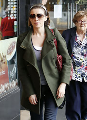 Dannii Minogue looked casual and classic in a pair of gold aviator sunglasses.