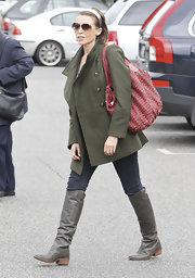 Dannie Minogue added a festive touch to her casual look with a red stud-embellished bag.