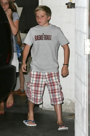 Plaid print cargo pants were a cool twist on this casual staple for Brooklyn Beckham.