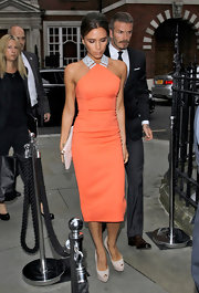 Victoria's blush peep toe pumps were a feminine finish to her bold orange dress.